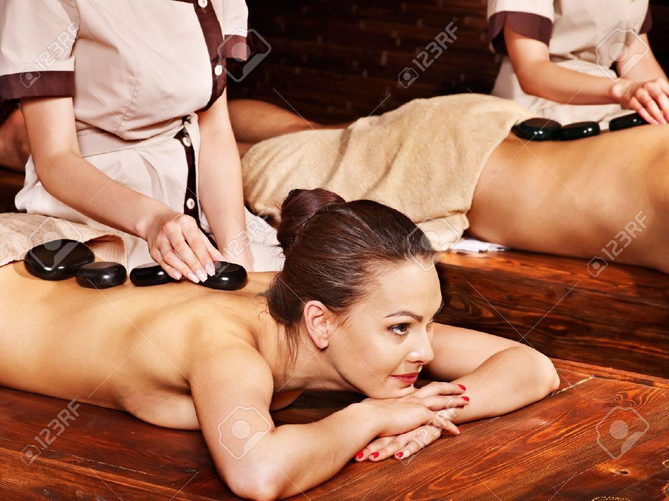 Couple  having stone Ayurveda spa treatment. Stock Photo - 22331957