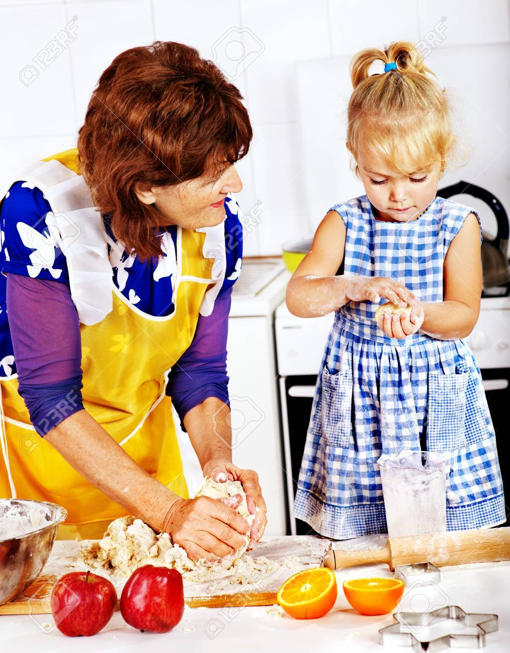 Grandmother and granddaughter baking cookies. Stock Photo - 22528669