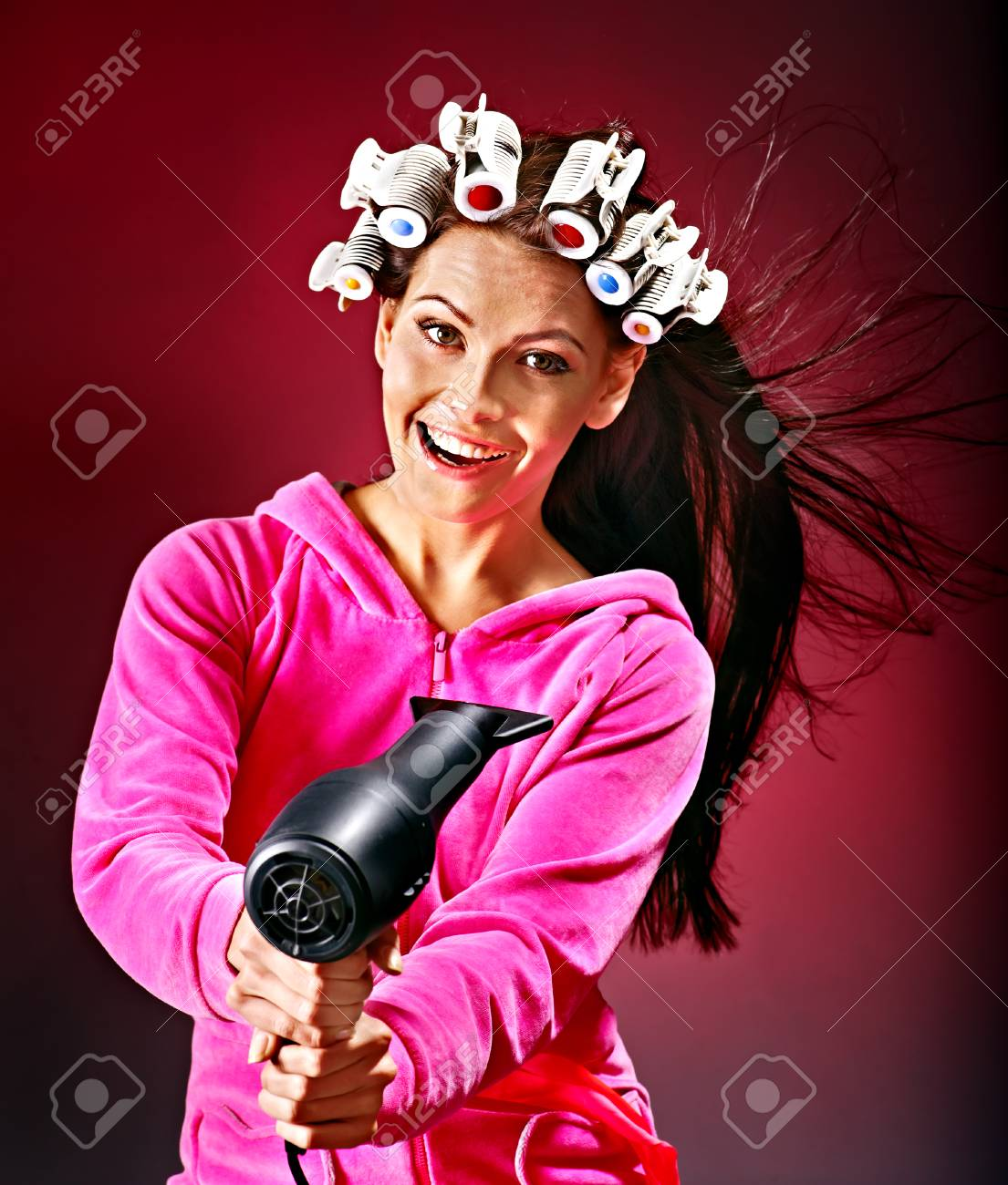 Happy woman wear hair curlers holding  hairdryer. Stock Photo - 23356187