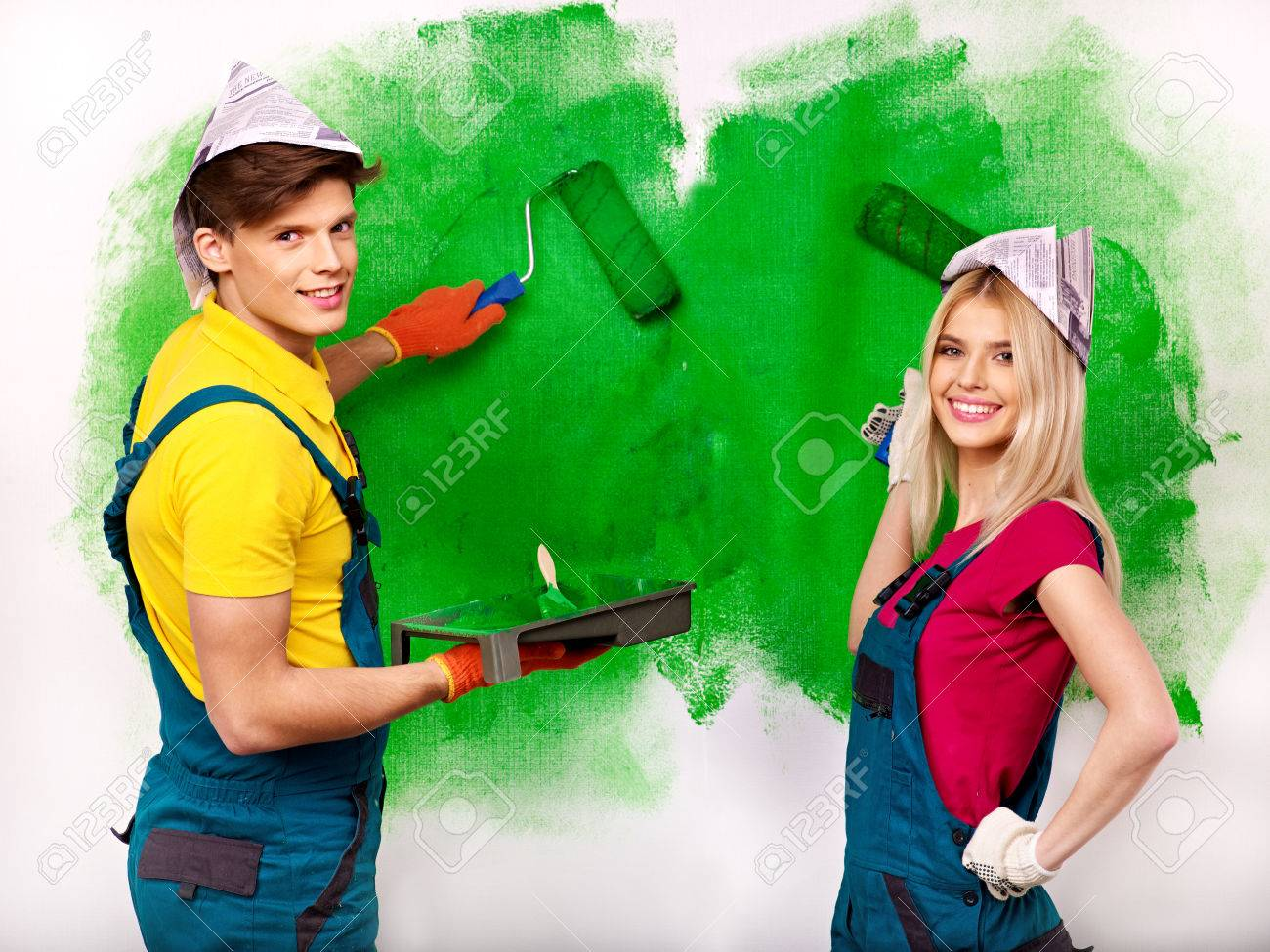 Happy family paint wall at home. - 23856425
