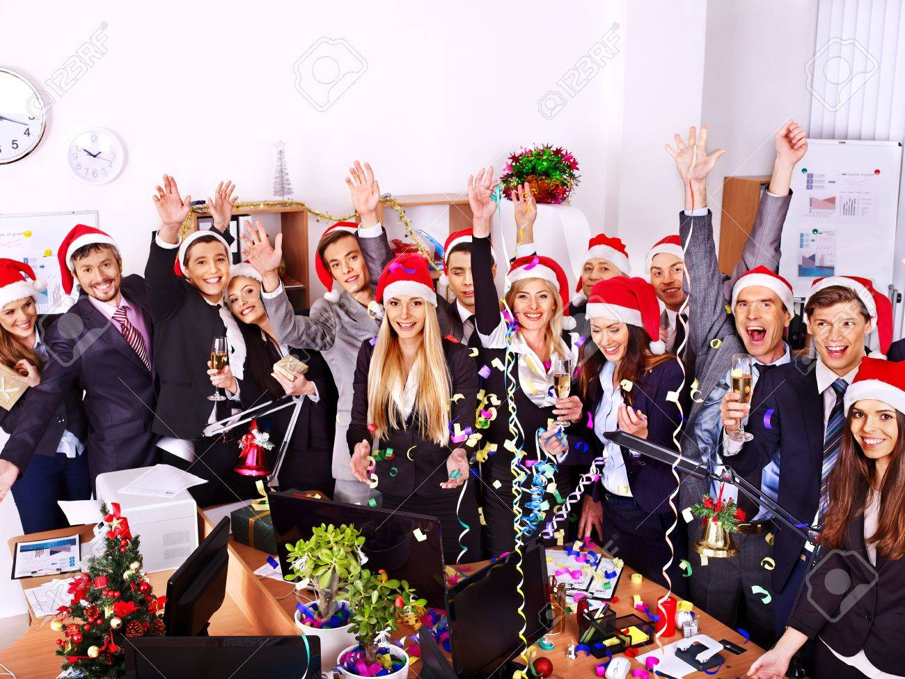 Happy business group people in santa hat at Xmas party. - 24041188