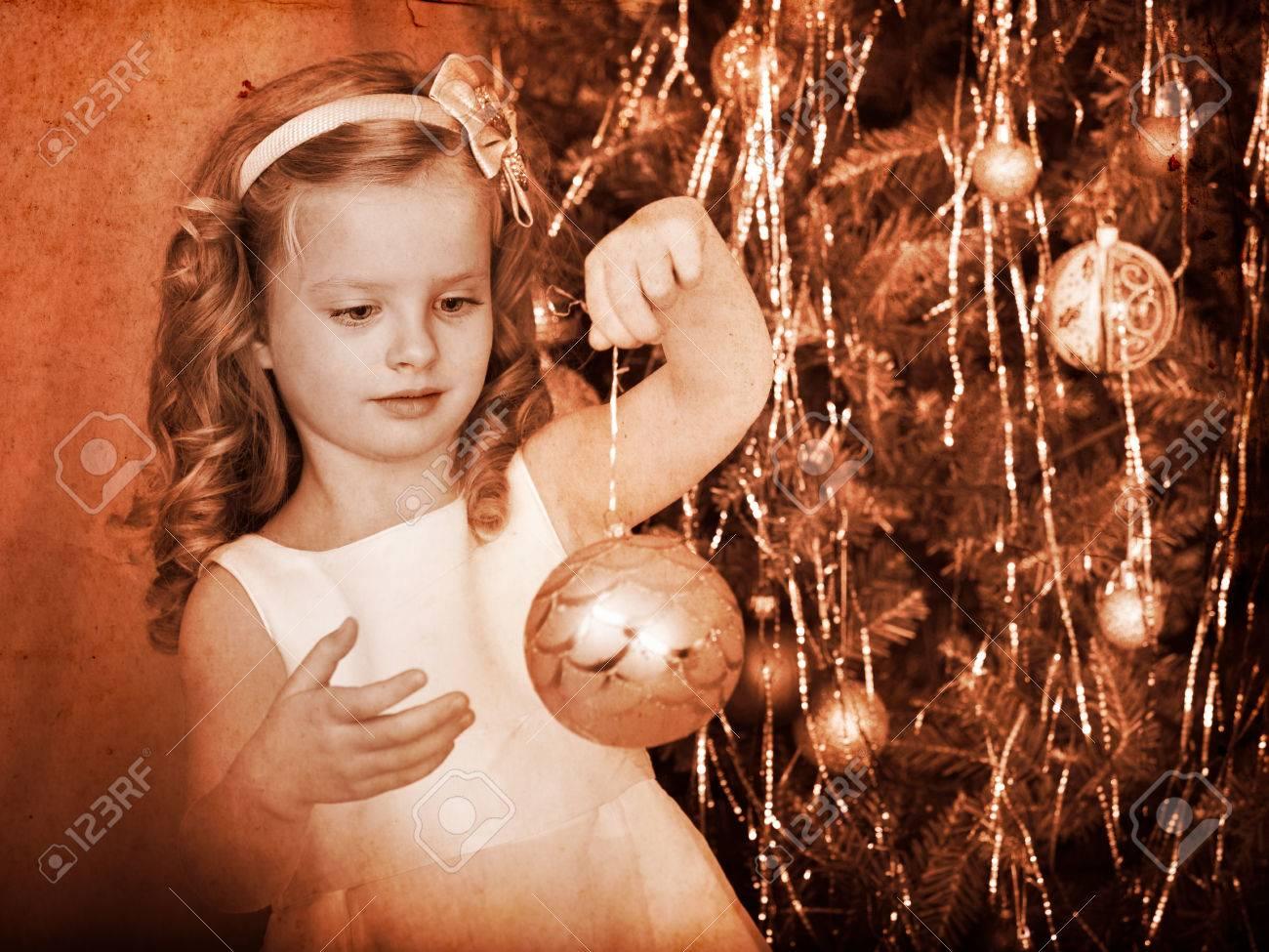 Child decorate on Christmas tree. Black and white retro. Stock Photo - 24177249