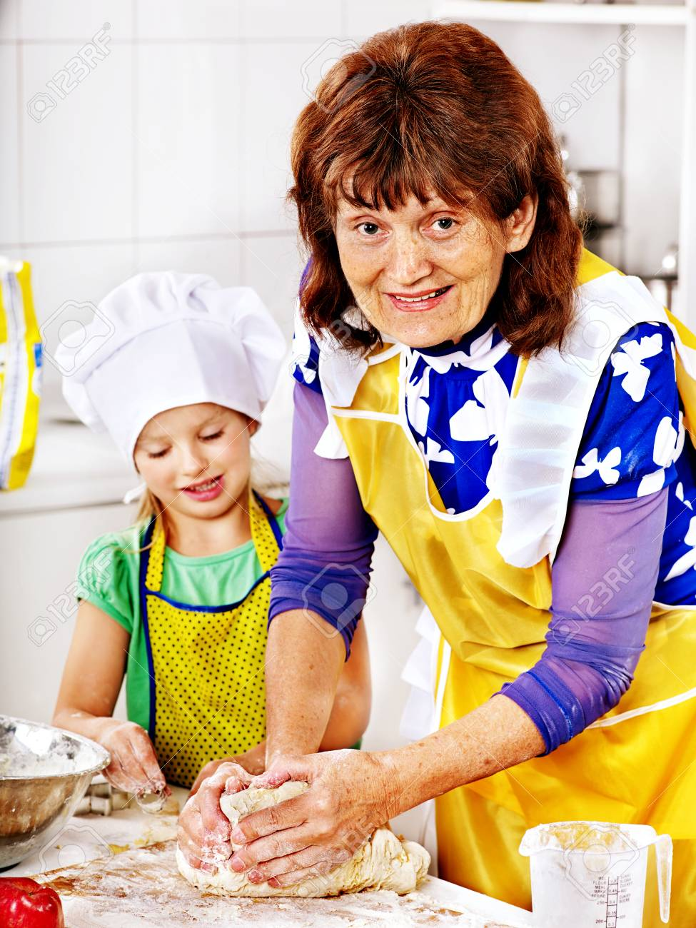 Grandmother and granddaughter baking cookies. Stock Photo - 25073932
