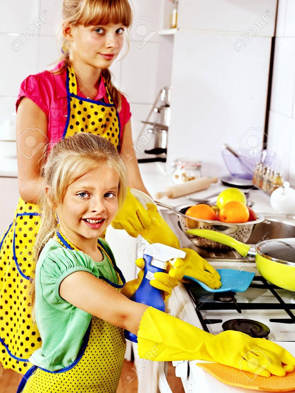 Children cleaning kitchen. Housekeeping. - 25073940