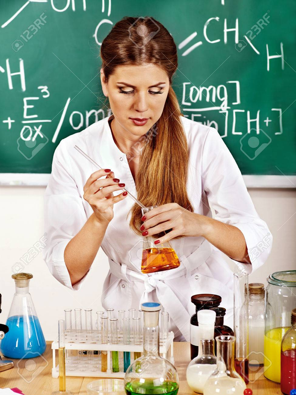 Chemistry Teacher With Test-tube At Classroom. Stock Photo ...