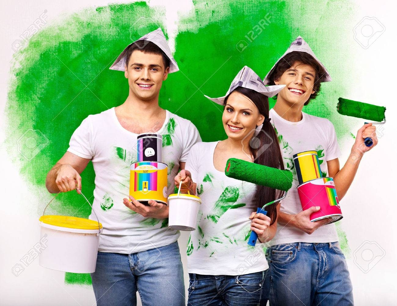 Happy family paint wall at home. - 25236983