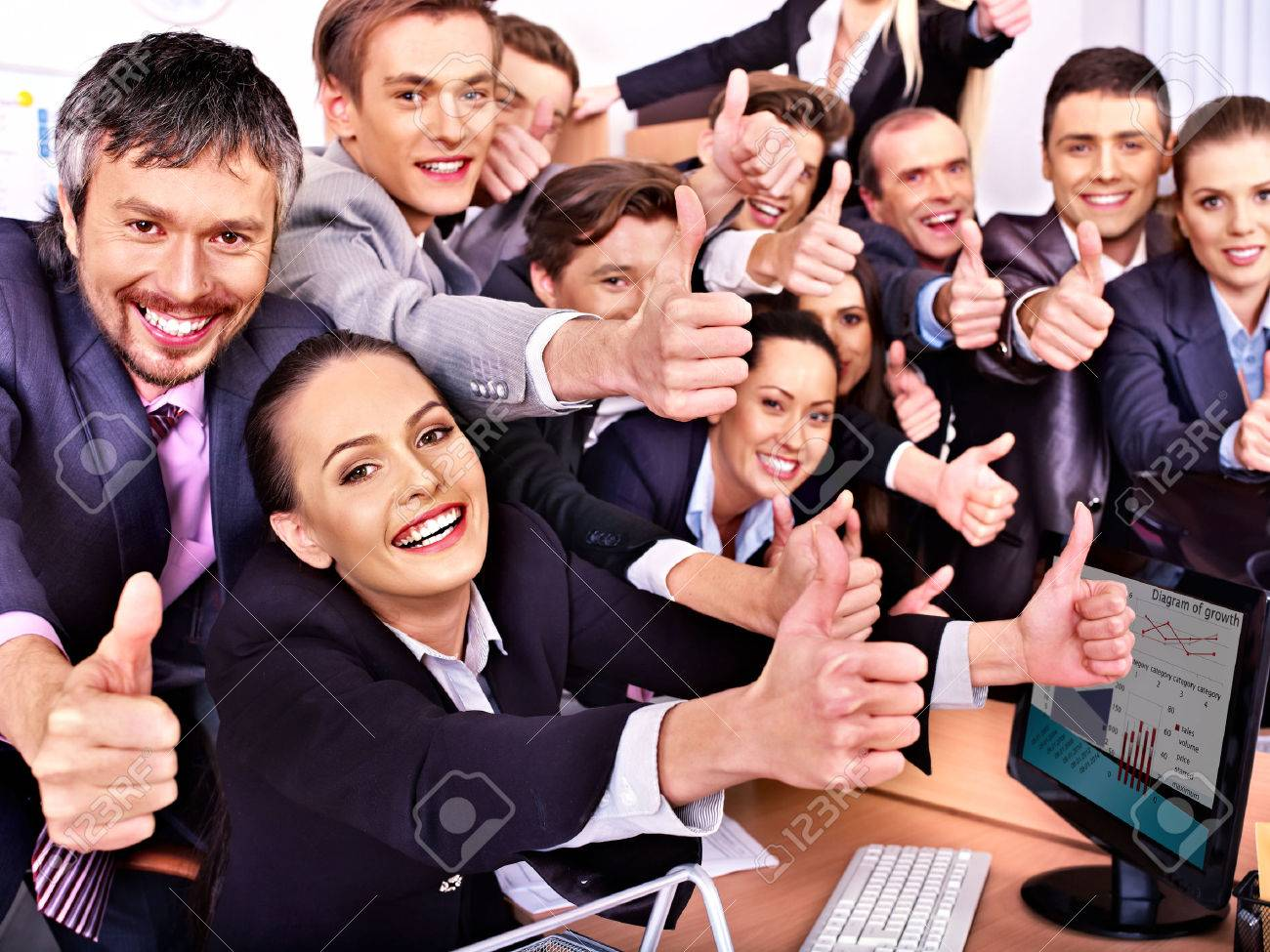Happy group business people thumb up in office. - 25573219