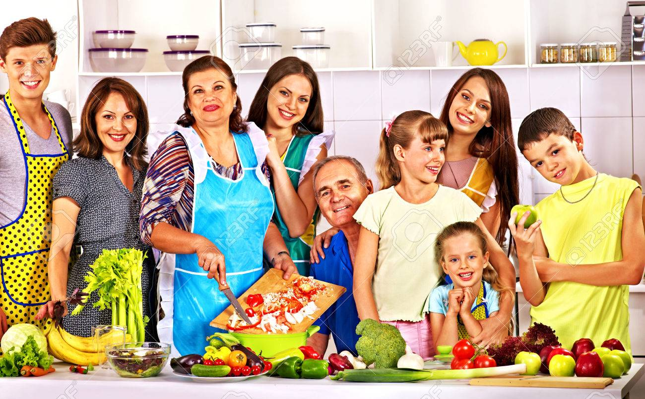 Happy family with child cooking at kitchen. Grandfather and grandmother. - 26529708