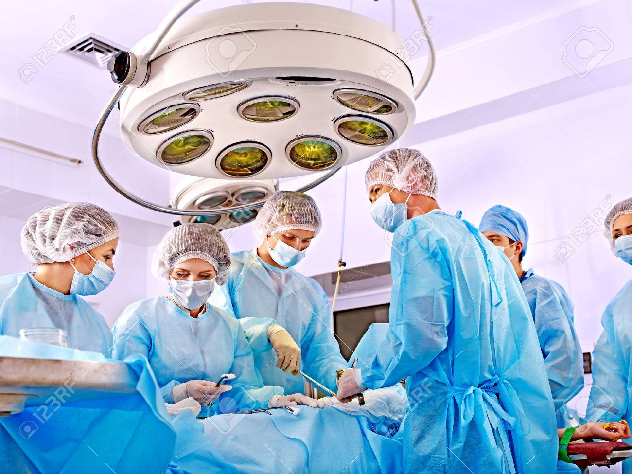 Team surgeon at work in operating room. - 27460716