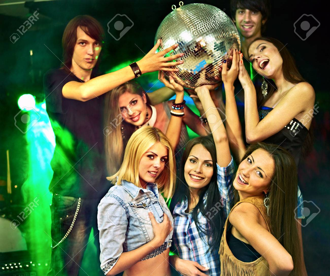 group people on disco in night club lighting effects stock photo