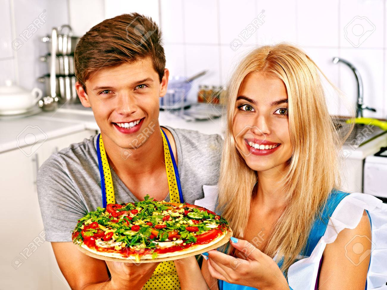 young happy family cooking pizza at kitchen. stock photo, picture, Kitchen design
