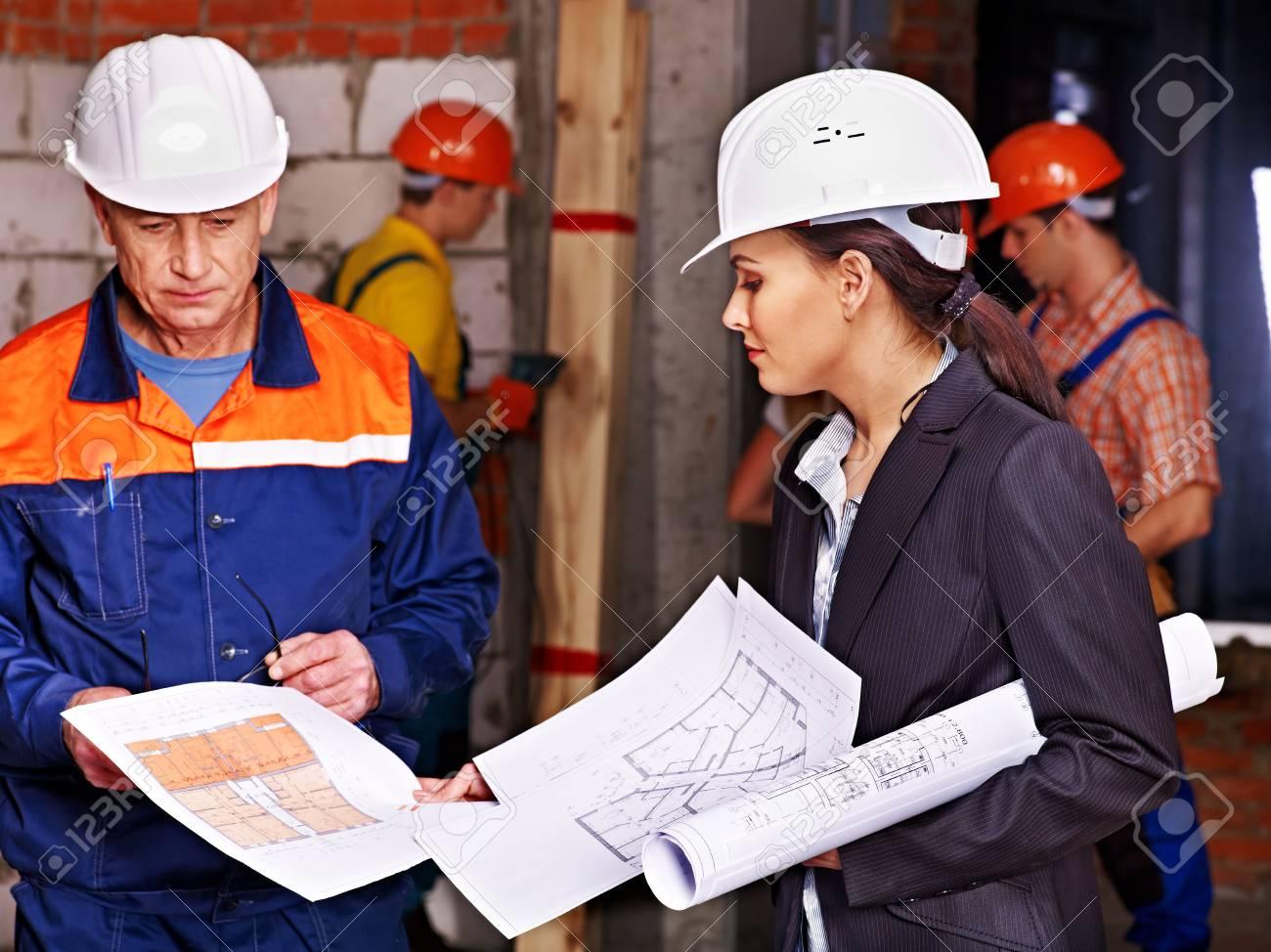 Business woman in builder helmet indoor. Stock Photo - 29368681