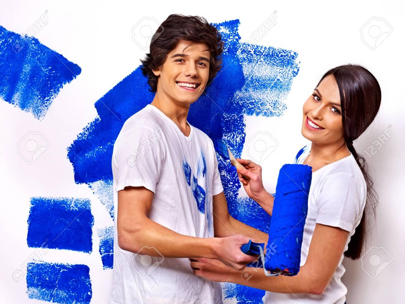 Happy family paint wall at home. Stock Photo - 29945623