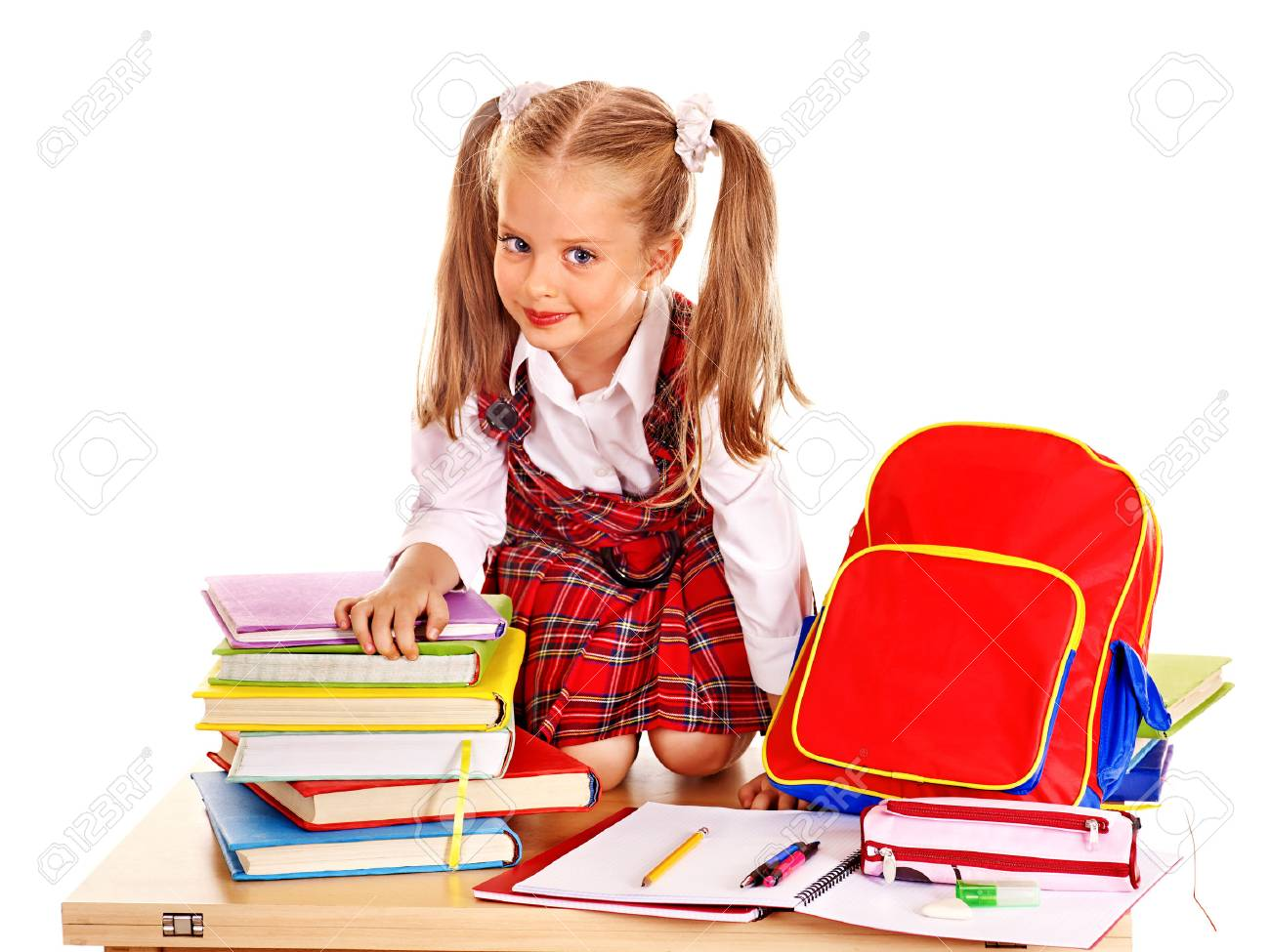Happy child with backpack holding book. Isolated. Stock Photo - 30839430 6f8d275e480d7
