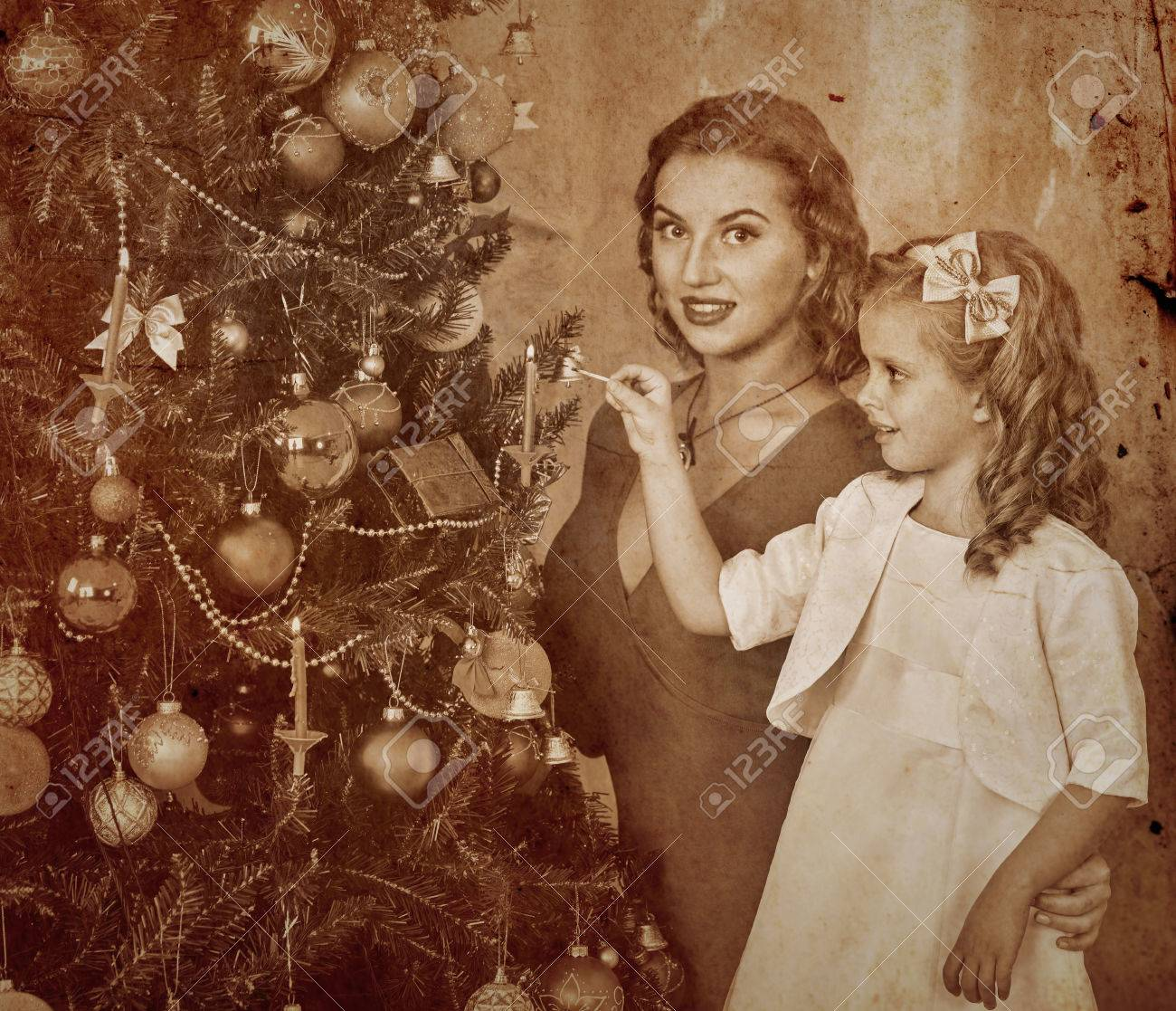 Happy Family With Children Dressing Christmas Tree. Stock Photo ...