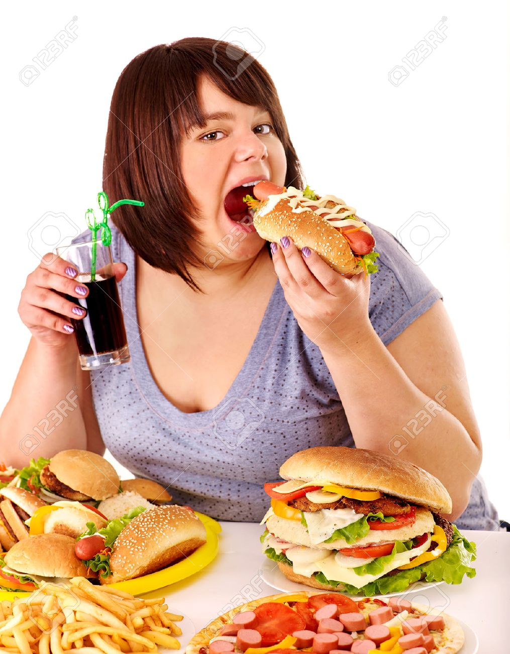 34389921-overweight-woman-eating-fast-fo