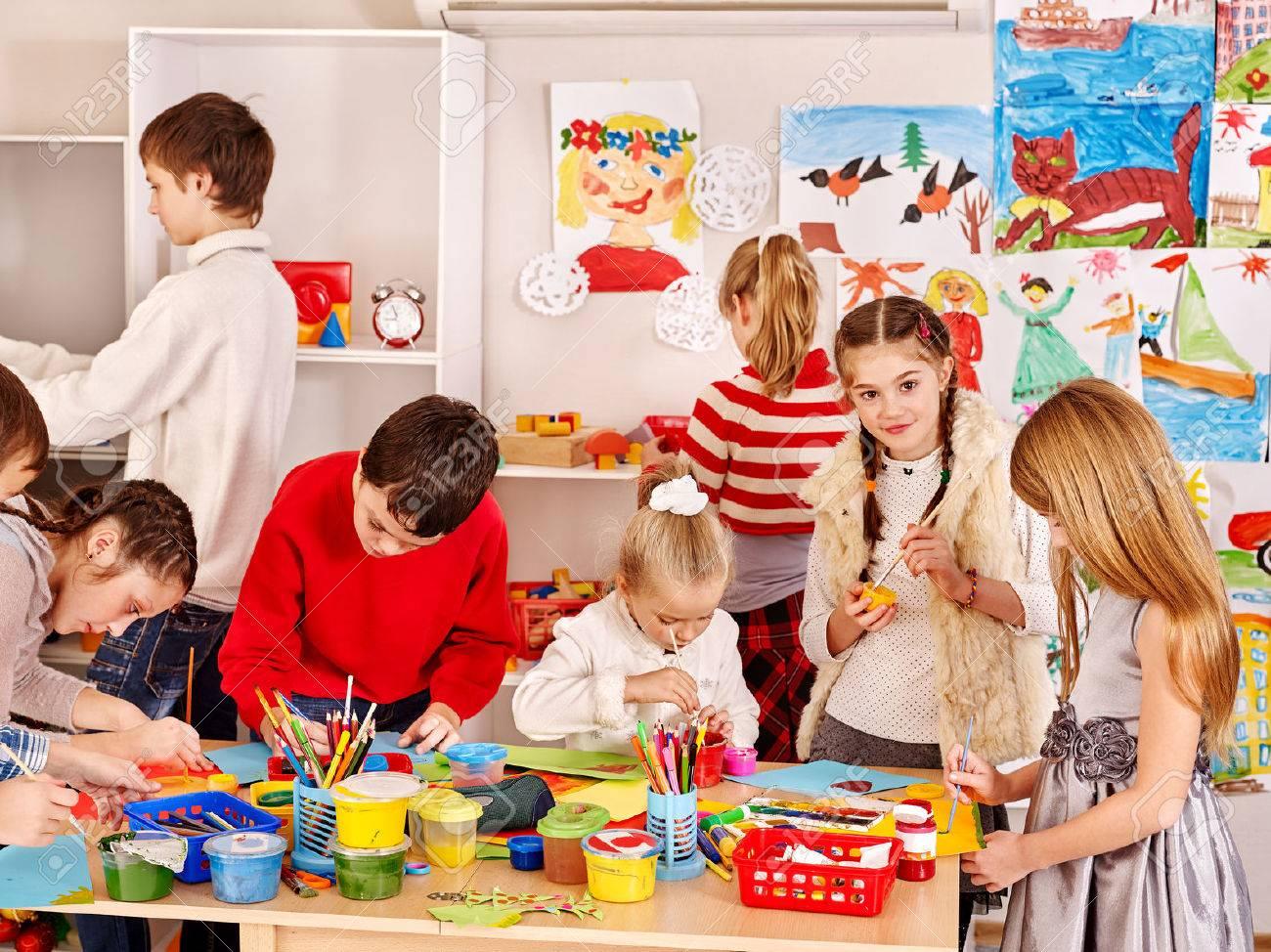 Child painting at art school. Education. - 34393107