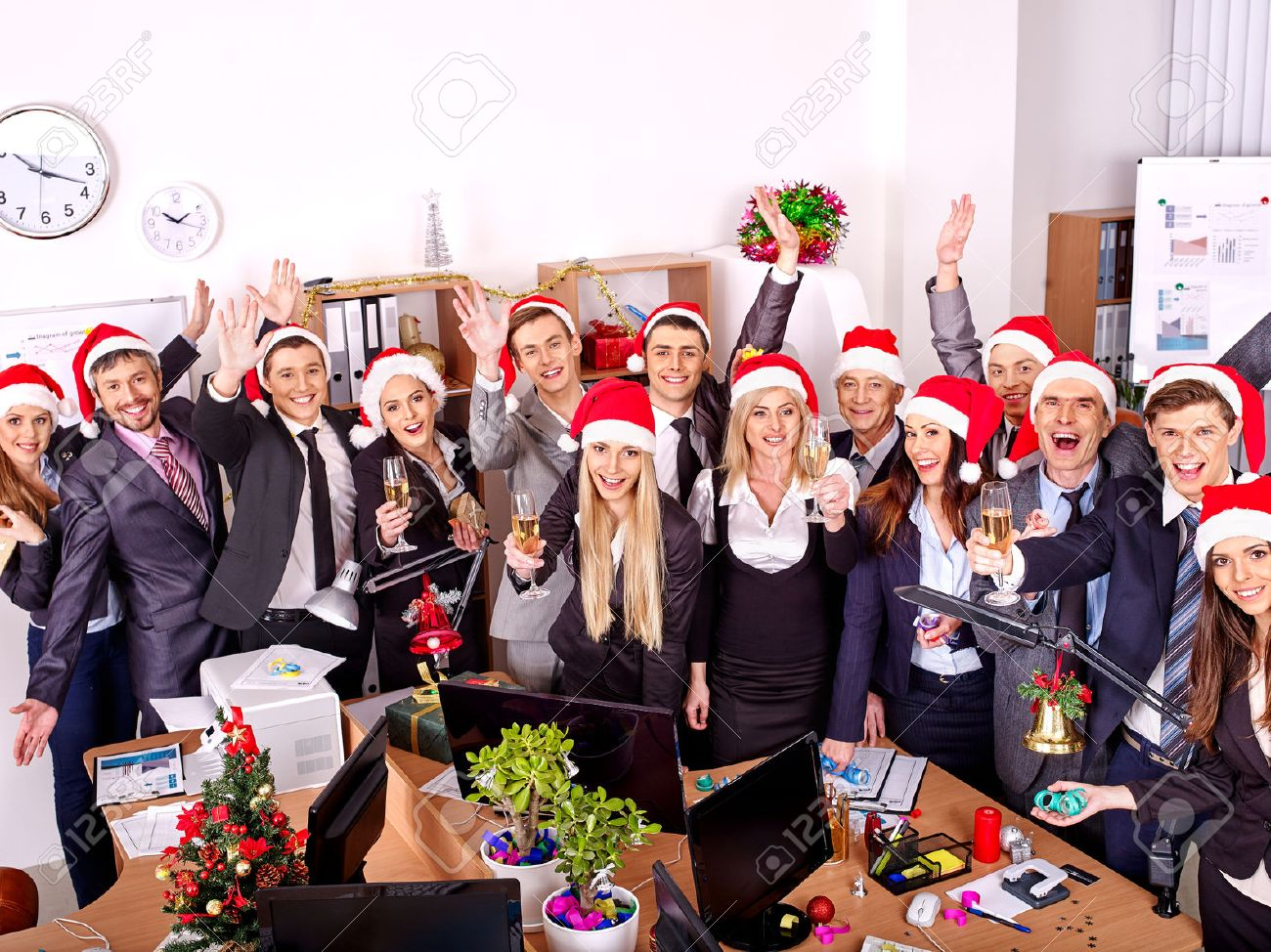 Happy group people in santa hat at Xmas business party. - 34393231