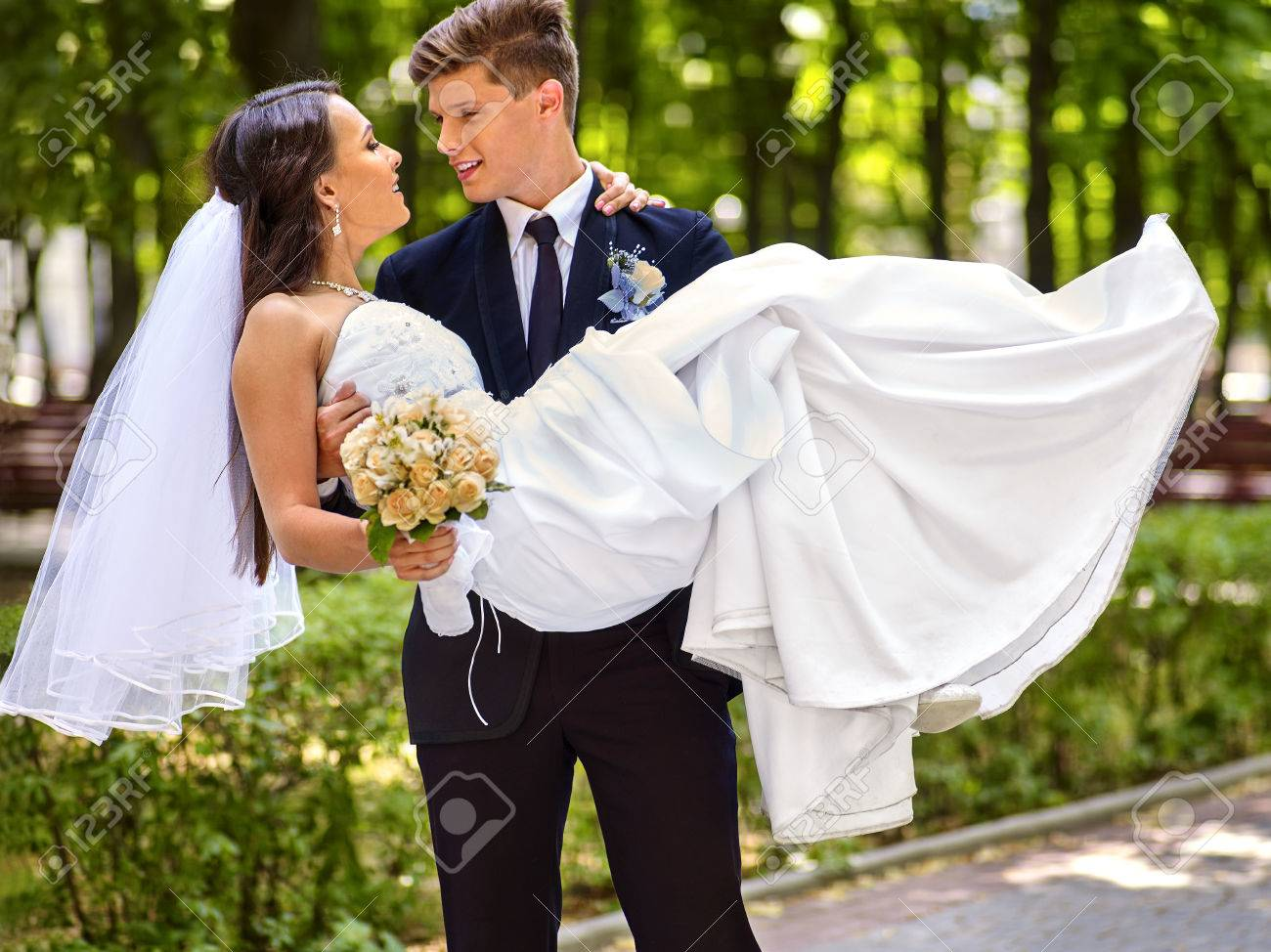 Bride and groom with flower summer outdoor. - 37457361