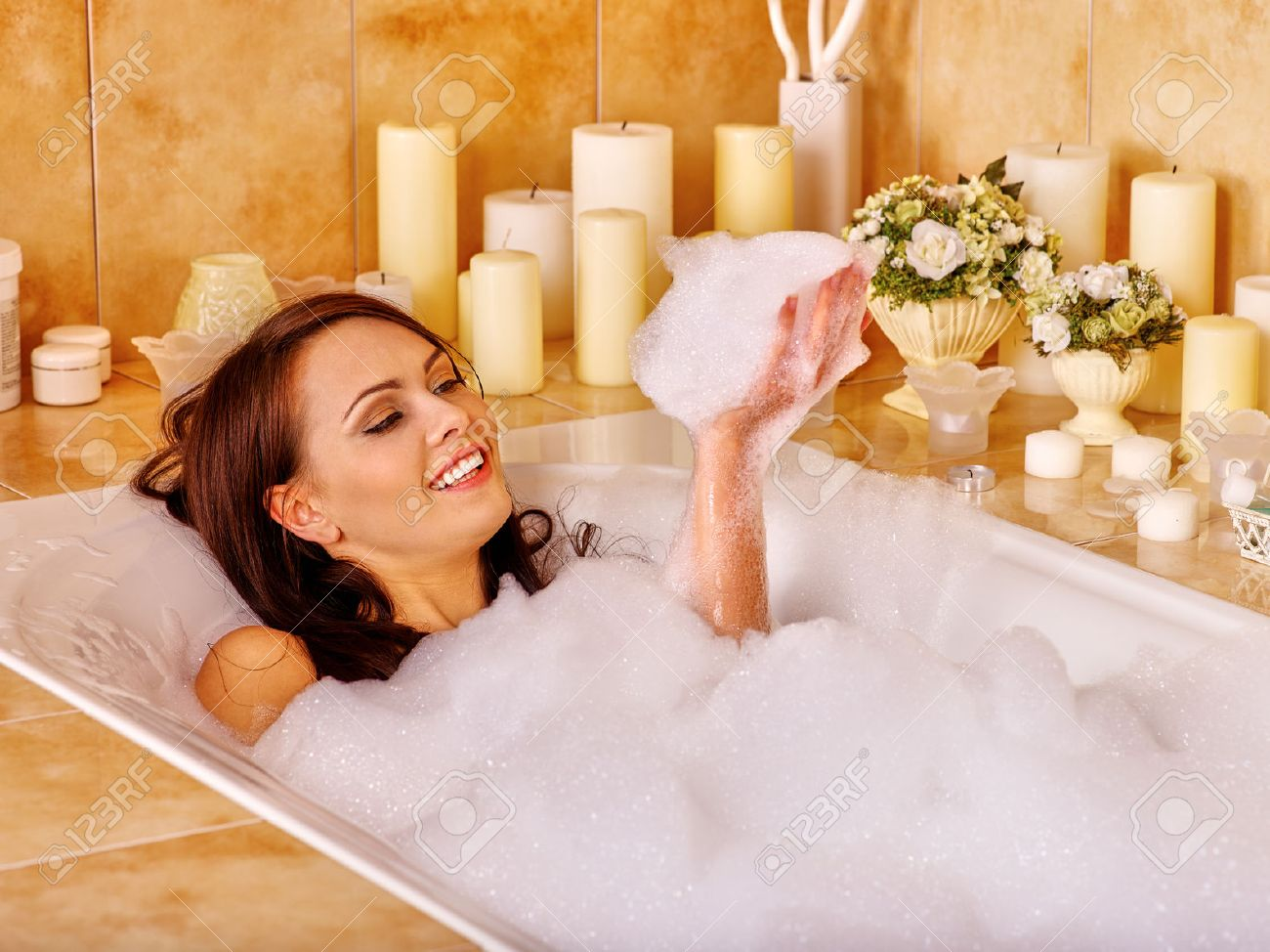 Woman relaxing at water in bubble bath. - 38740906