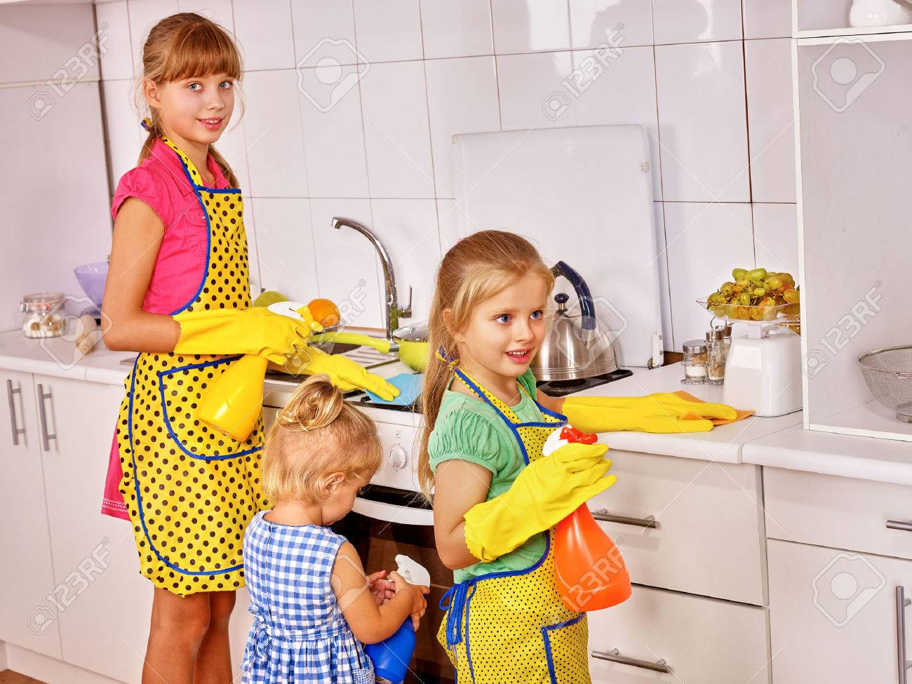 White gloves apron cleaning services - Dish Washing Gloves Children Little Girl Cooking At Kitchen Stock Photo