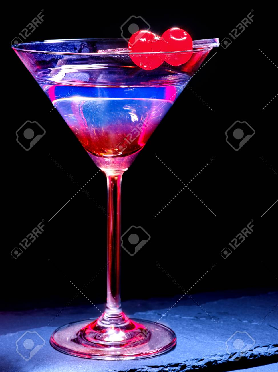 transparent cherry cocktail on black background cocktail card