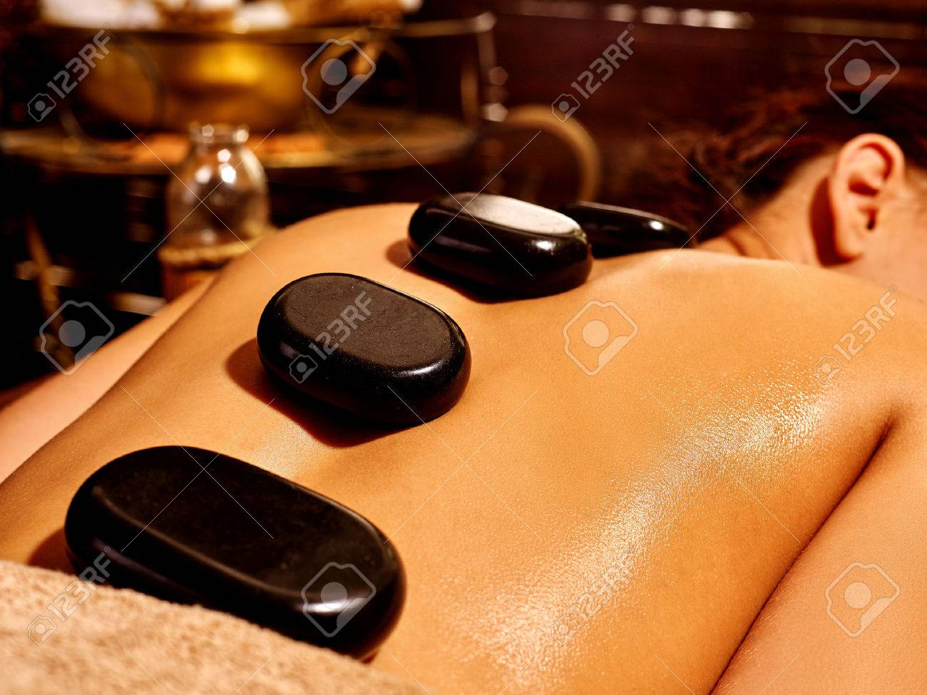 Young woman having Ayurveda stone massage. - 40645102