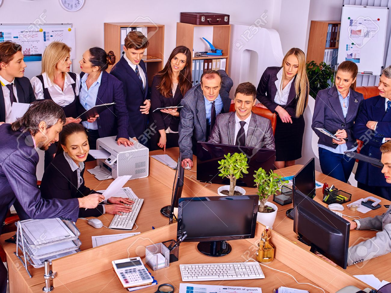 Happy group business people in office. - 40873674