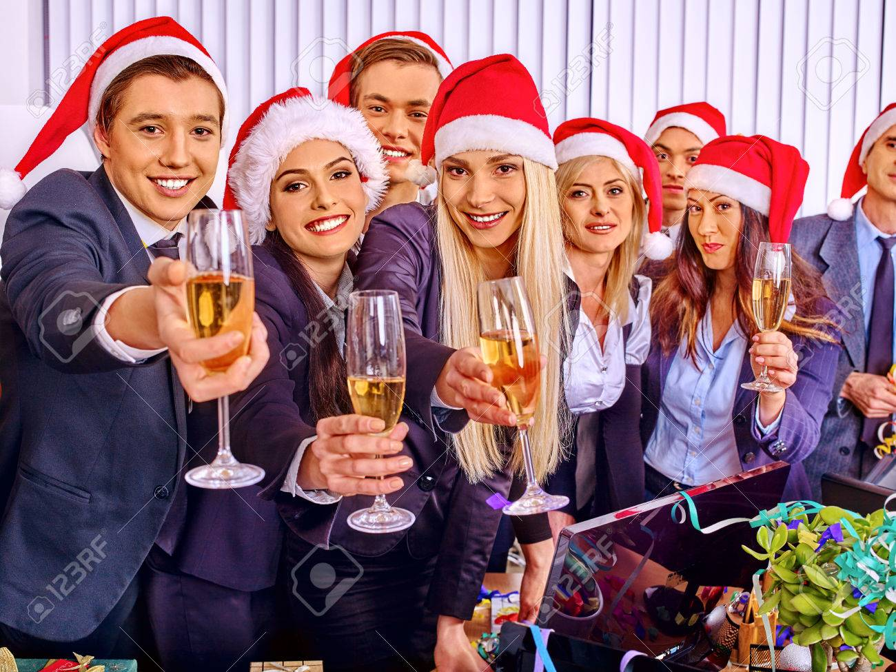 Happy business group people in santa hat at Xmas corporate party. - 47316924