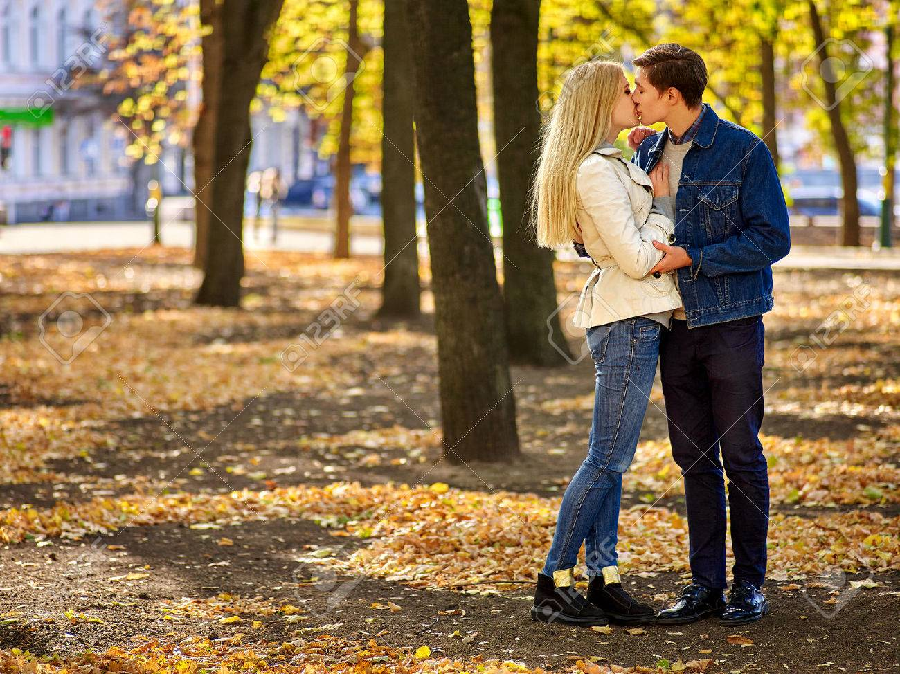 Young couple hugging and flirting in park. Full height. - 47419270