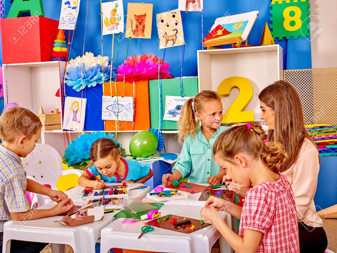 Lasrge Group beauty kids sculpt by plasticine on table in kindergarten . - 48495029