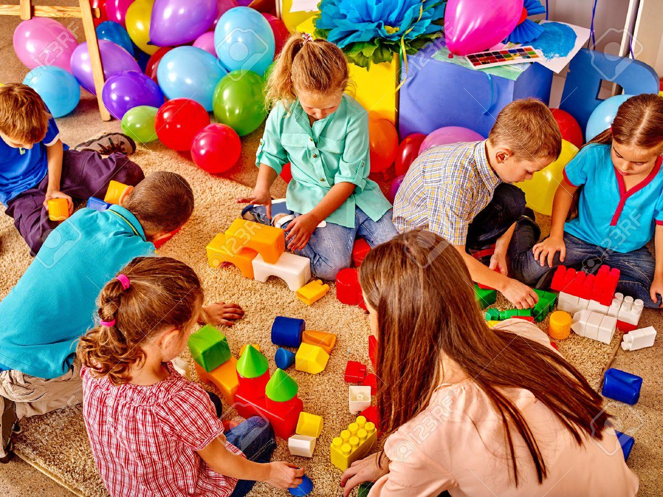 Group children game blocks and balloons on floor in kindergarten . Top view. - 48495034