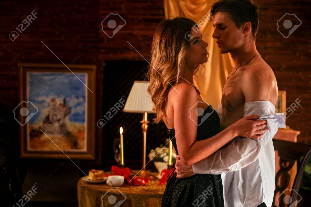 Couple in love dancing and kissing into luxury restaurant. - 63299837