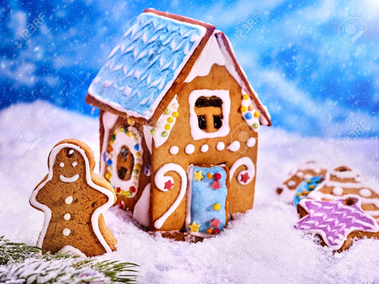 Christmas Gingerbread House Background.Christmas Gingerbread Man Close Up Outside Of Gingerbread House