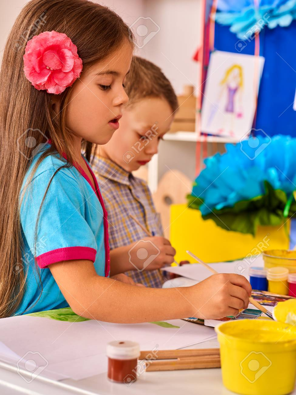 Small Students Painting In Art School Class Child Drawing By