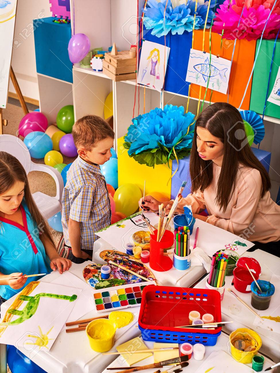 Childrens Paint Brushes And Children Painting And Drawing In.. Stock ...