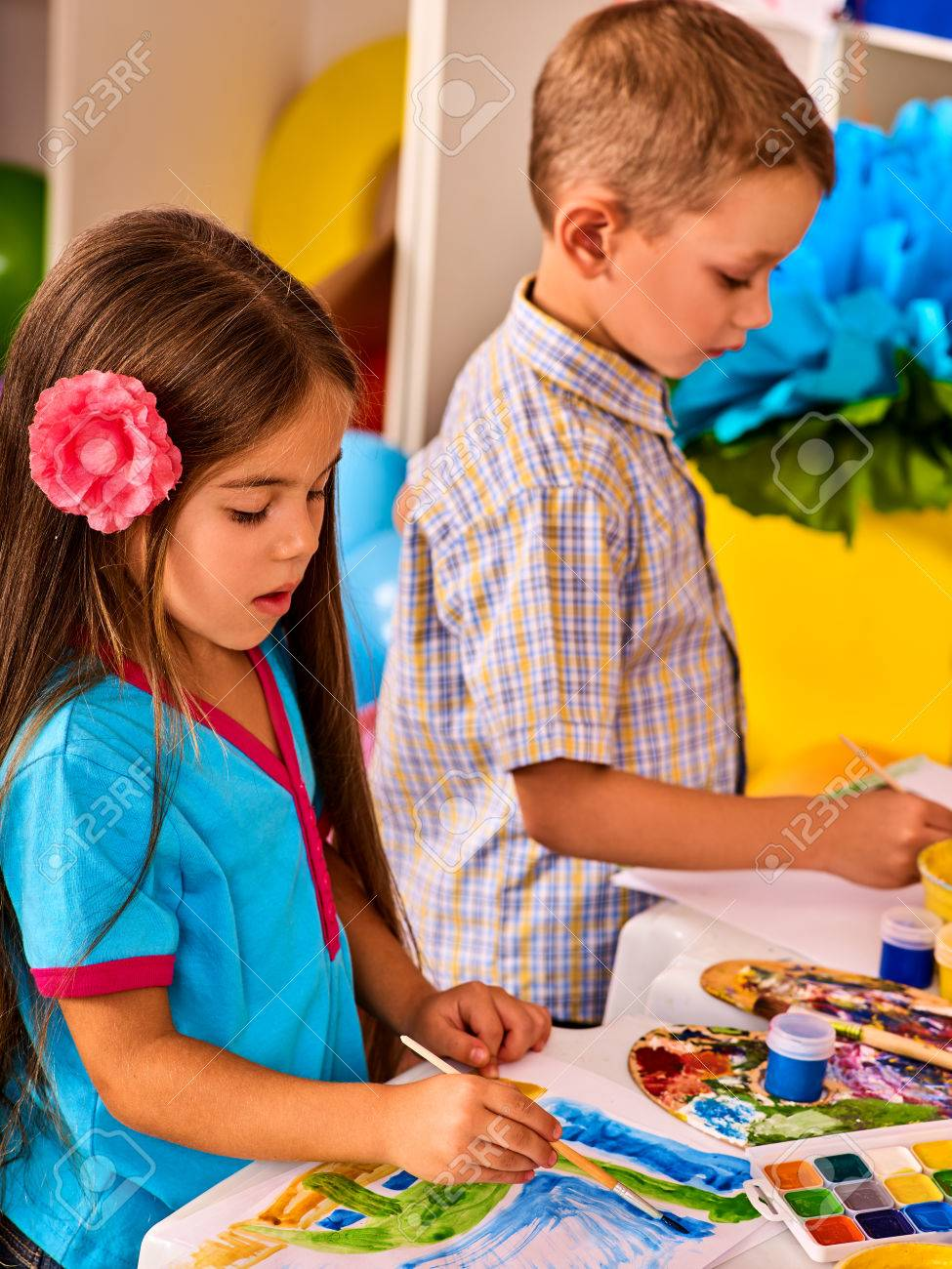 Small Students Girl And Boy Painting In Art School Class. Child ...