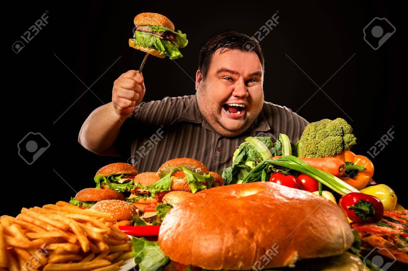 Diet Fat Man Who Makes Choice Between Healthy And Unhealthy Food Stock Photo Picture And Royalty Free Image Image 77910549