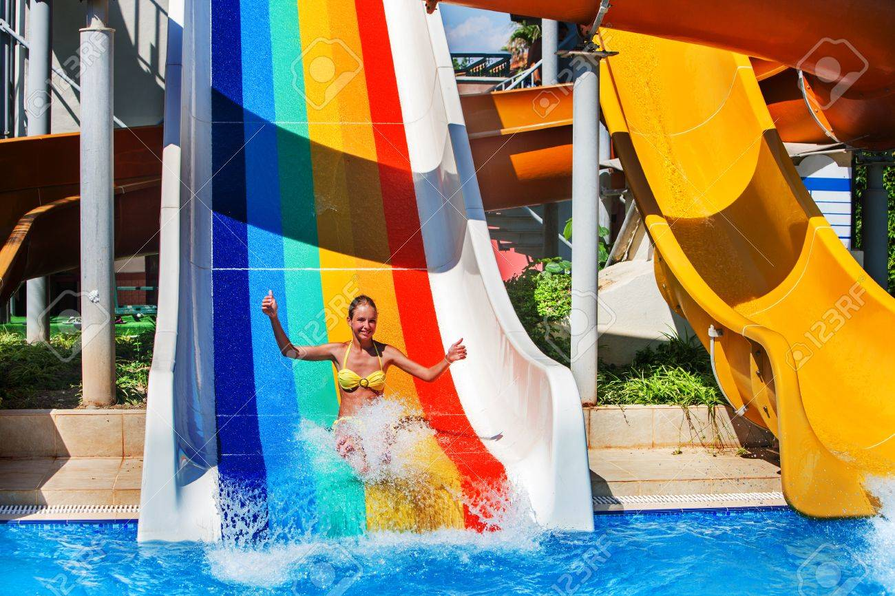 Swimming Pool Slides For Children On Blue Water Slide At Aquapark ...
