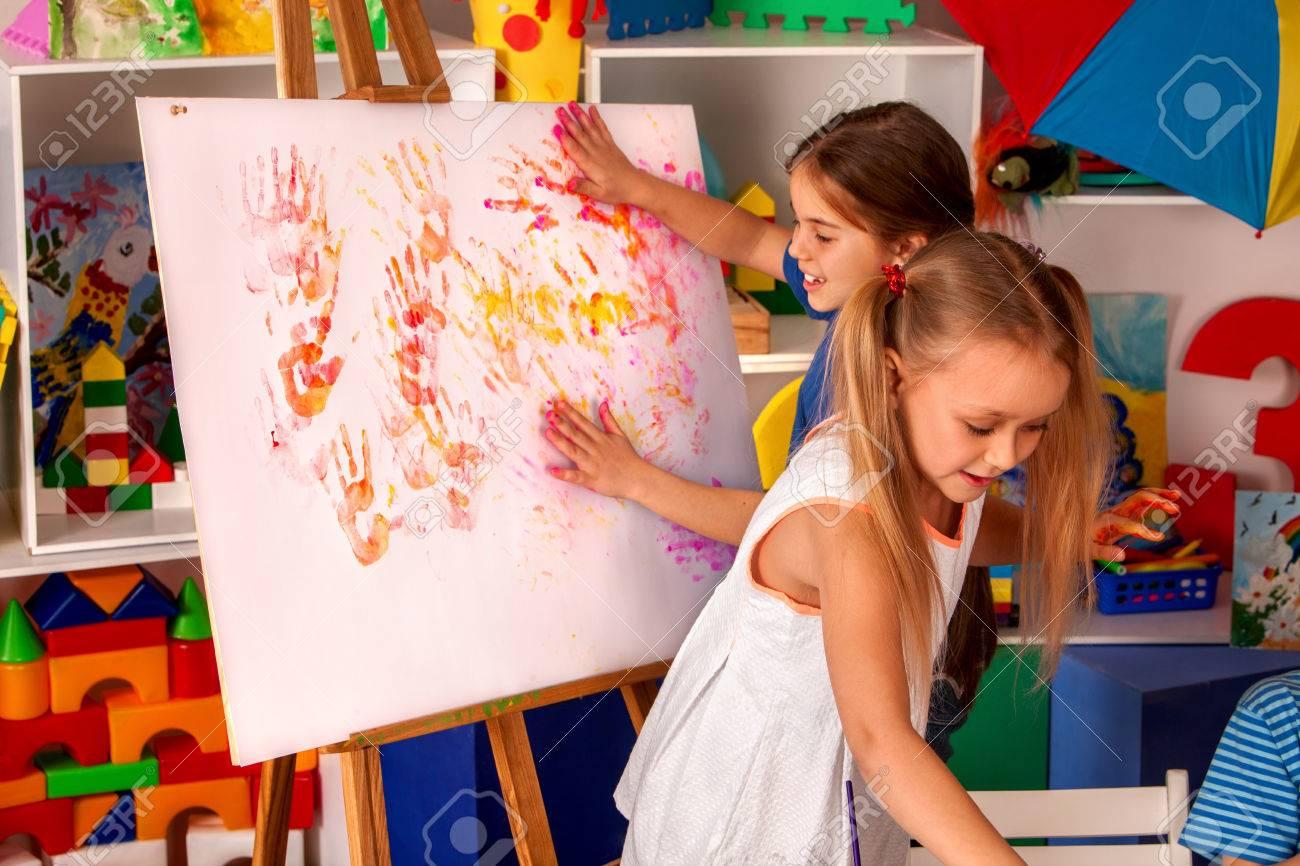 Children Painting Finger On Easel. Group Of Kids Girl Learn Paint ...