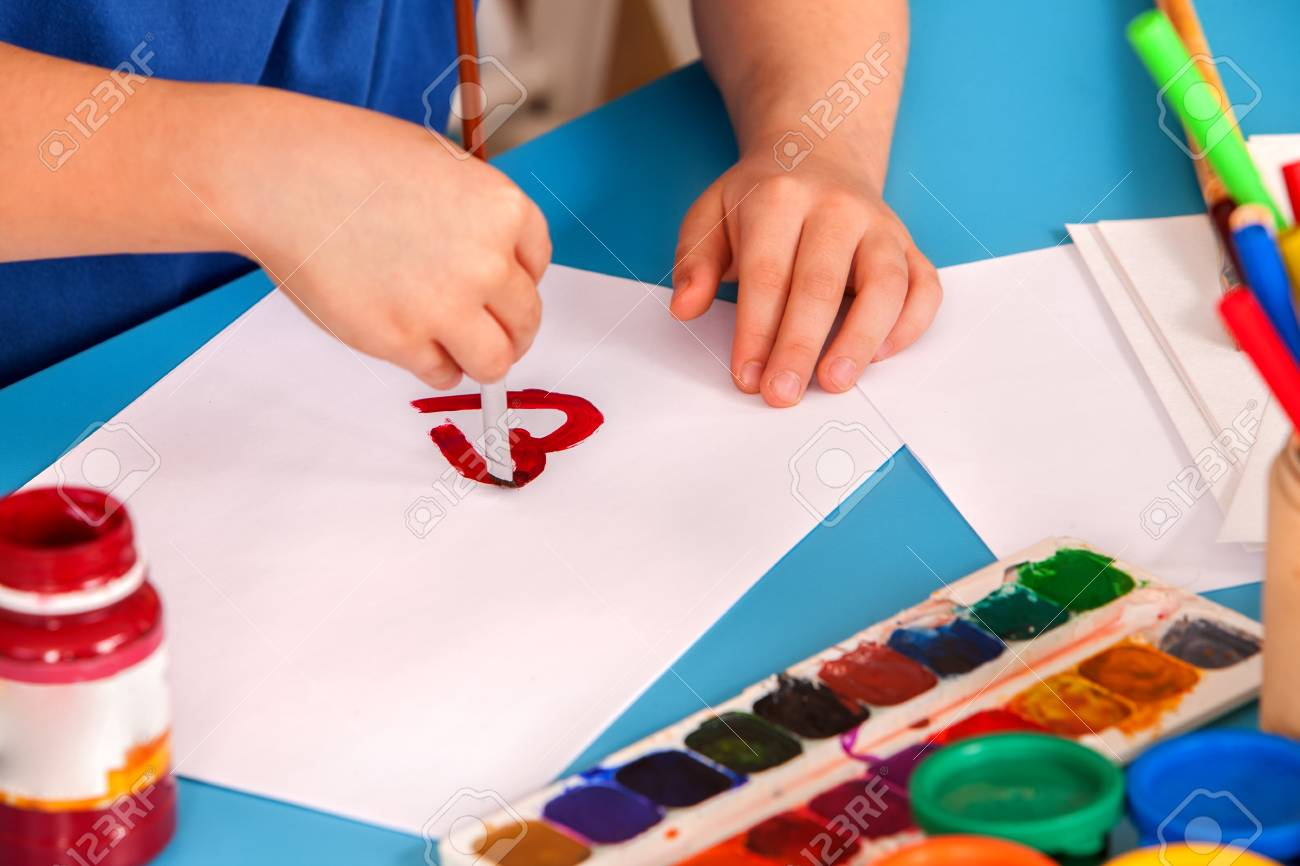 Hands Of Small Student Painting Heart In Art School Class. Child ...