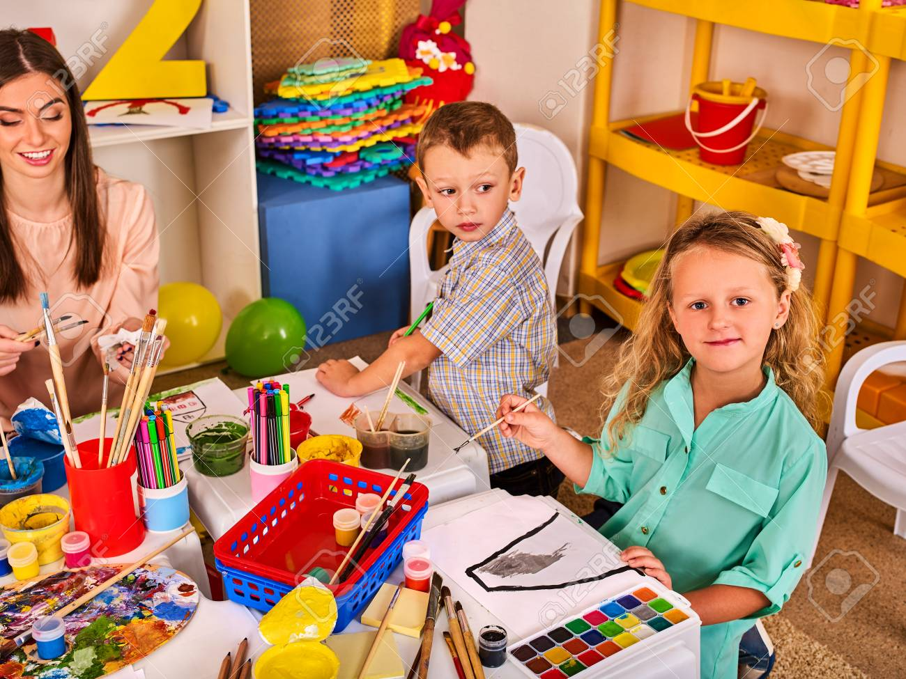 kids playroom organization of children painting and drawing in kids club craft lesson in primary - Children Painting Images