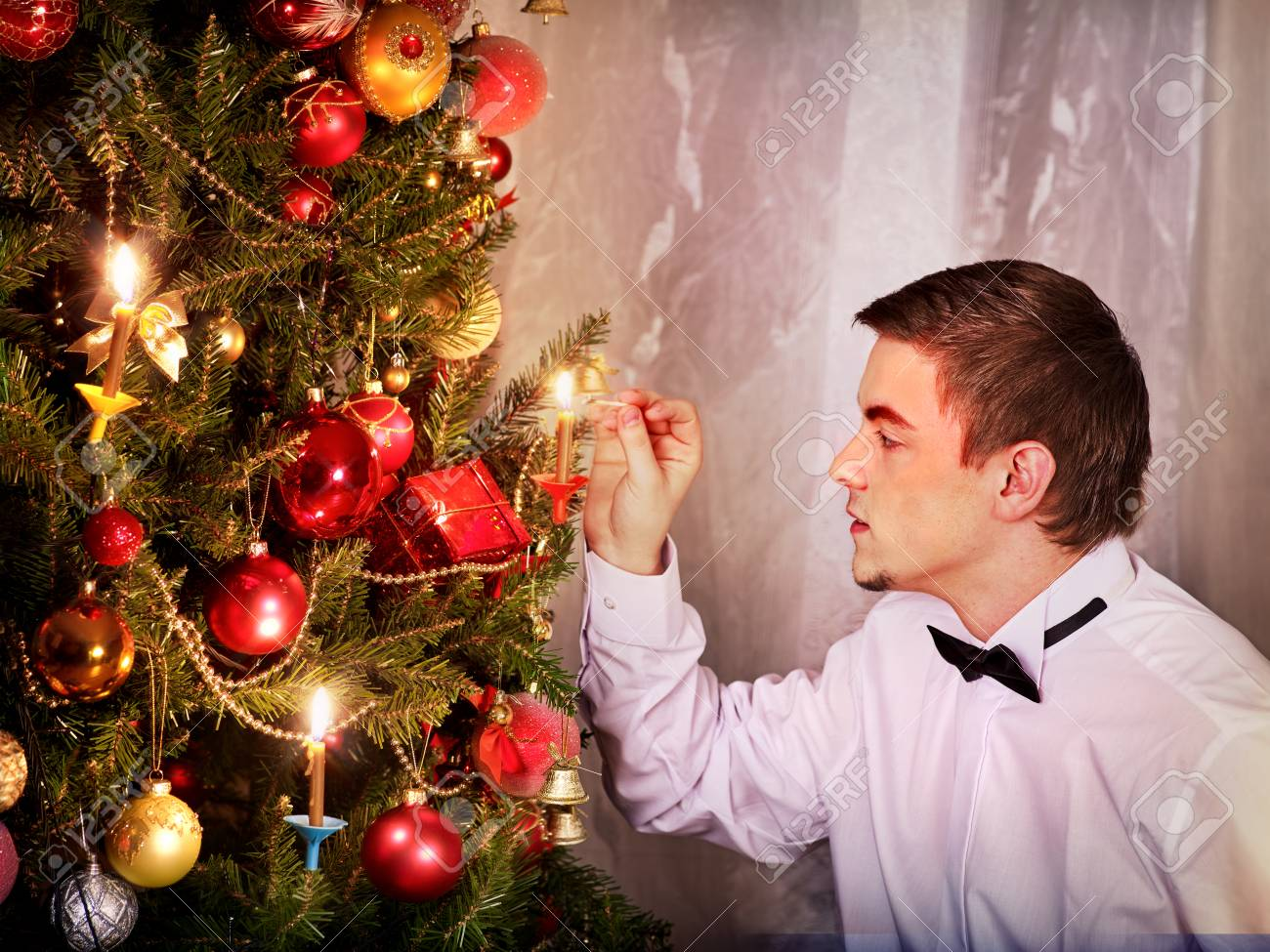 Man Dressing Christmas Tree Expectation Of Holiday On Eve Xmas Party At Home Alone