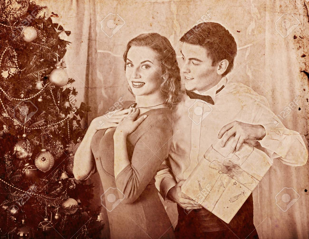 Christmas Nostalgy Couple On Party Near Xmas Tree Take Gift Box Stock Photo Picture And Royalty Free Image Image 91699596