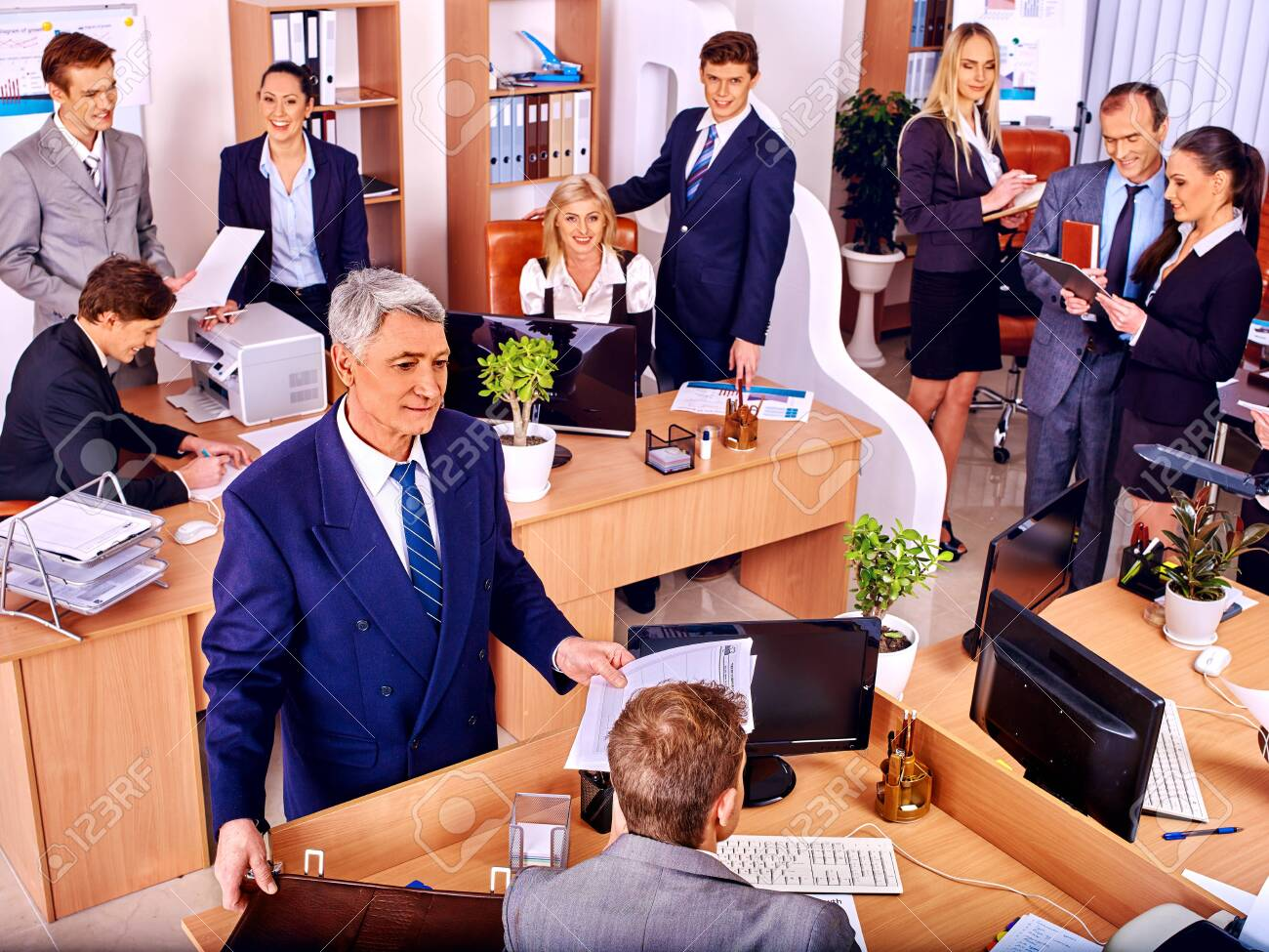 Happy group business people in office. Old man. - 122314979