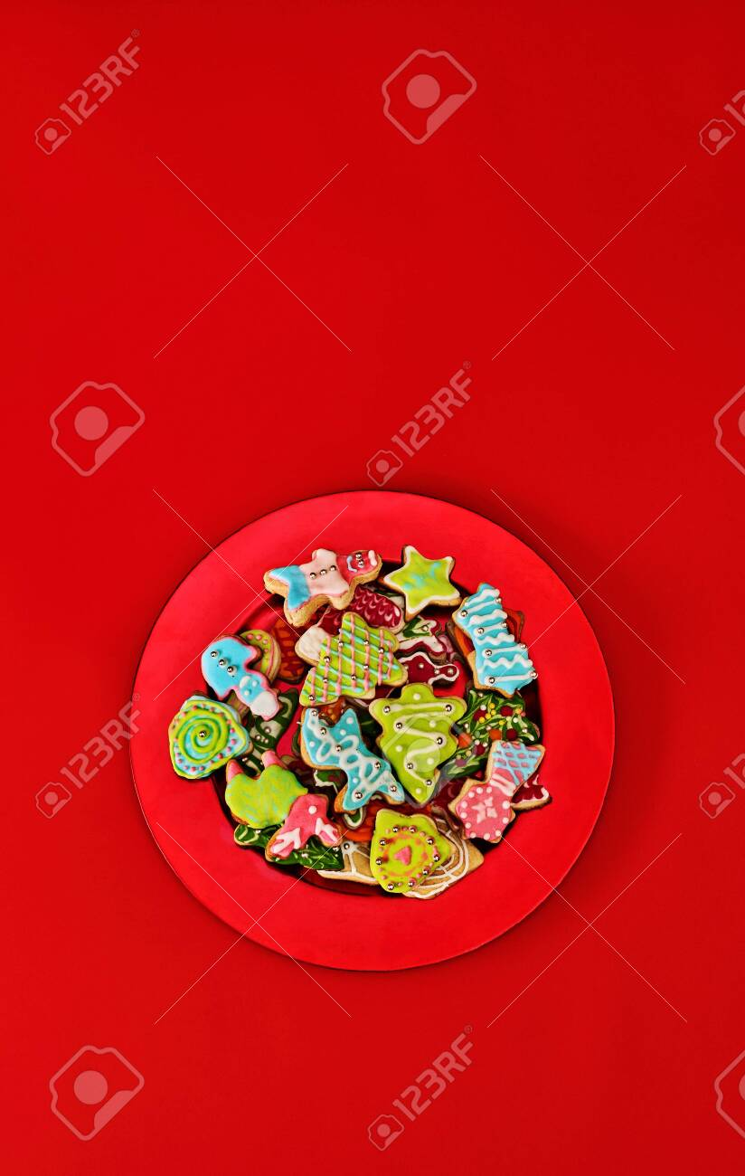 Christmas gingerbread cookies on red Xmas plate and same color background . Top view long vertical design frame with copy space top. - 133939669
