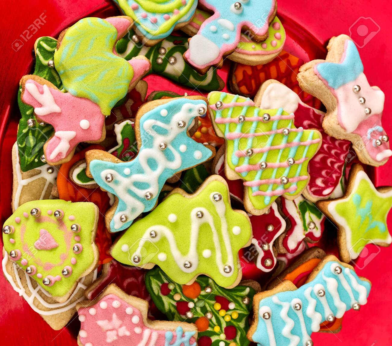 Christmas gingerbread cookies on red Xmas plate and same color background . Close up top view square design frame. - 133939671