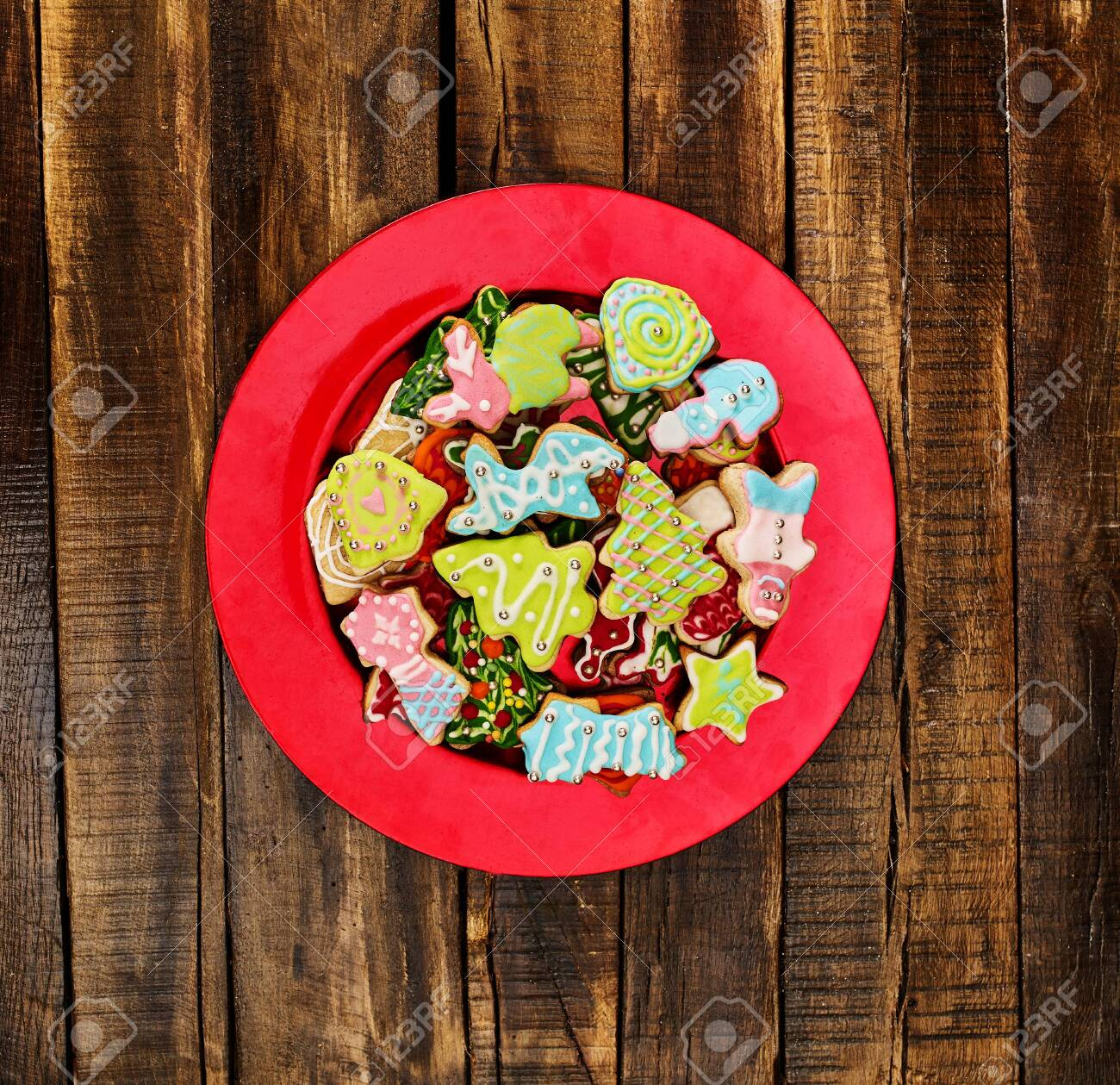 Christmas gingerbread cookies on red Xmas plate and wooden boards background . Top view square design frame with copy space top. - 133939723