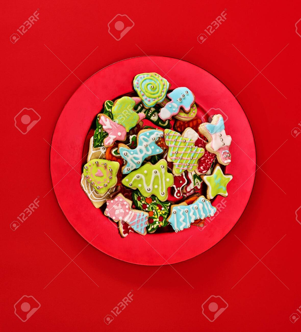 Christmas gingerbread cookies on red Xmas plate and same color background . Top view long vertical design frame with copy space top. - 133939734