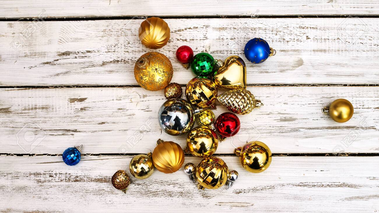 Christmas decorations design top view of Xmas balls ornaments on white wooden boards . Horizontal frame banner. - 133940061